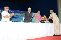 Mr. Bhatia honouring the Chief Minister